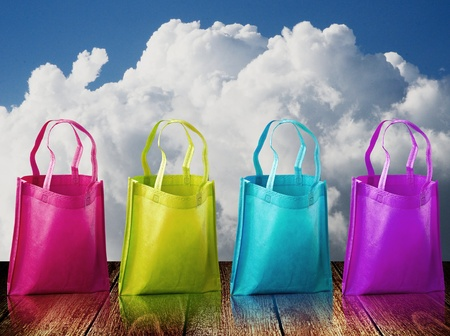in need of space: Shopping bag on wooden table with nice sky Stock Photo