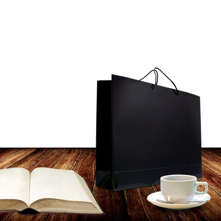 Nice glossy shopping bag on nice wooden floor  photo