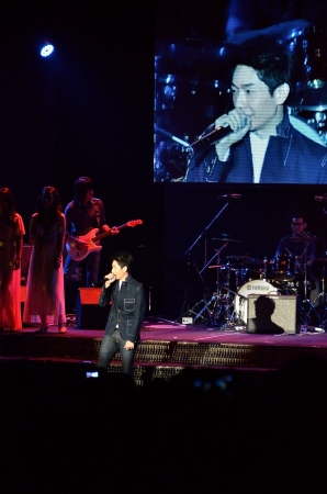 peacemaker: BANGKOK, THAILAND � NOV 18 : Boy Peacemaker or Anuwat Sanguansakphakdee Christian singer singing and show in Crossover Live  Concert on 18 November 2012 at Bangkok Christian College, Bangkok, Thailand