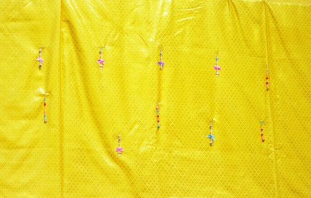Yellow fabric to decorate inside Buddhist temple background Stock Photo - 16475942