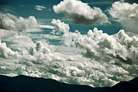 Drama cloud in the sky with mountain background photo