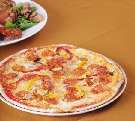 Pizza on table, Italian food concept photo