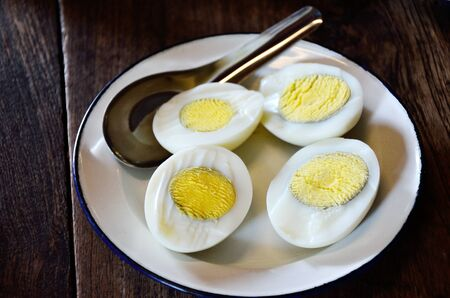 Half of boiled egg in white vintage dish photo