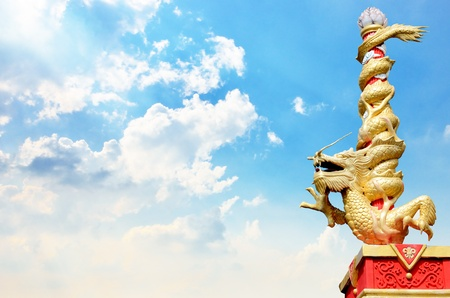 Dragon statue roll the column with nice sky background photo