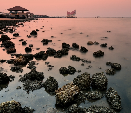 Sea and stone at Sriracha, Chonburi, Thailand photo