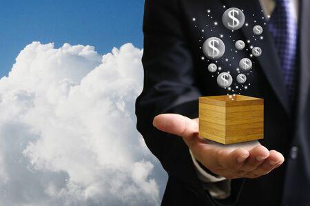 money box: Bubble economy concept, Businessman carry the money box Stock Photo