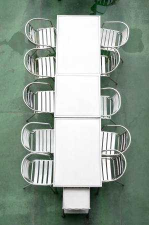 table top view: Top view of Metal table and chair with wet floor