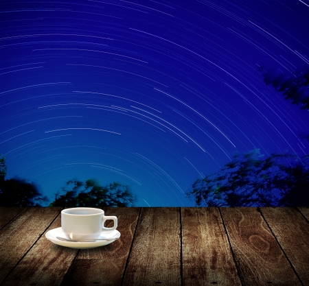 astrophotography: Drink coffee cup with star trails background
