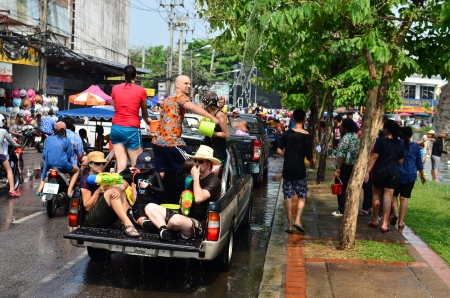 watergun: CHIANG MAI, THAILAND - APRIL 12 : People celebrating Songkran (Thai new year  water festival) in the streets by throwing water at each other on 12 April 2013 in Chiang Mai, Thailand Editorial