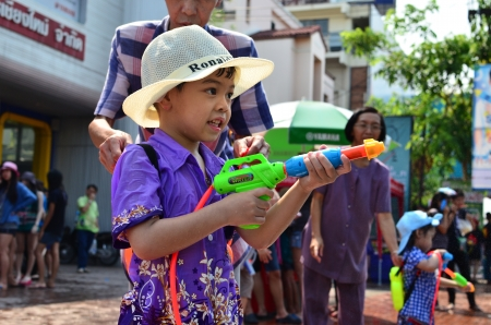 CHIANG MAI, THAILAND - APRIL 13 : Young people celebrating Songkran (Thai new year  water festival) in the streets by throwing water at each other on 13 April 2013 in Chiang Mai, Thailand