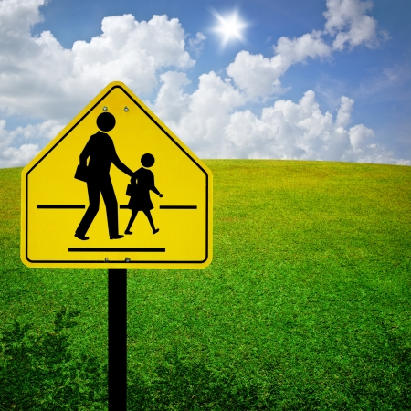 School Zone Sign With Field Background photo