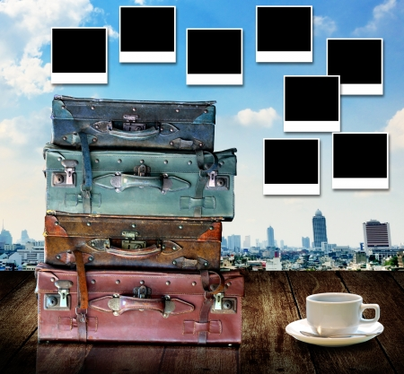 Travel memories concept, Vintage travel bag and photo frame with city view background photo