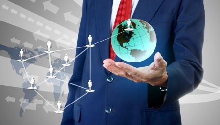 accessing: Businessman accessing global social network Stock Photo
