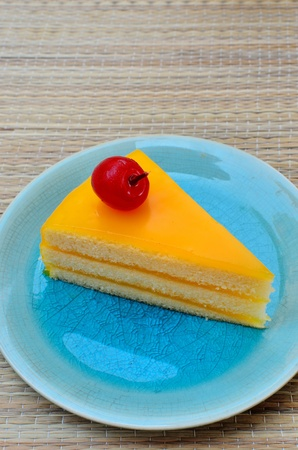 orange cake: Orange cake in blue dish, Sweet dessert Stock Photo