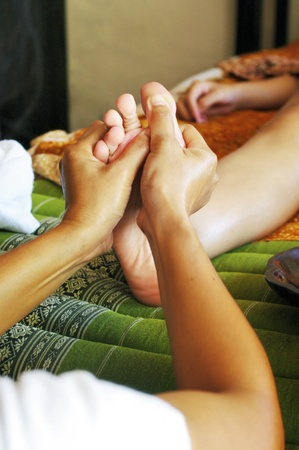 Foot massage, Reflexology concept photo