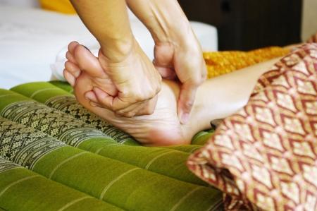 thai style: Foot massage in Thai style, Reflexology concept