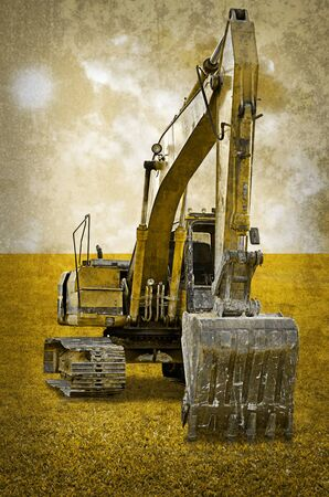 Track-type loader excavator machine on green grass field photo