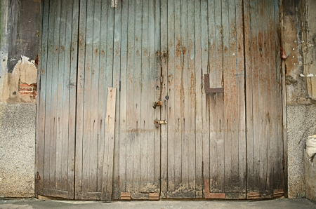 Old grungy wooden door, Thailand photo