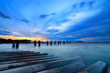 Sunset sky and bridge column in the sea with Sichang island background photo