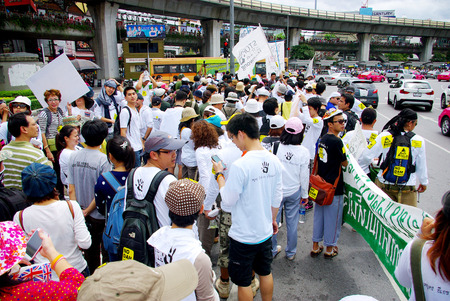 environmentalists: BANGKOK, THAILAND - SEPTEMBER 22   People walking for against the construction of a dam in Mae Wong National Park on 22 September 2013 at Victory monument, Bangkok, Thailand