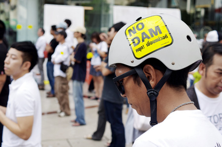 BANGKOK, THAILAND - SEPTEMBER 22   Unidentified man with campaign sticker on helmet for against the construction of a dam in Mae Wong National Park on 22 September 2013 at Bangkok Art and Culture Centre, Thailand Editorial