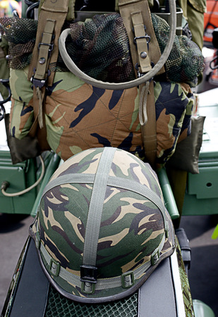 helmet seat: Motorcycle helmet on seat in military style Stock Photo