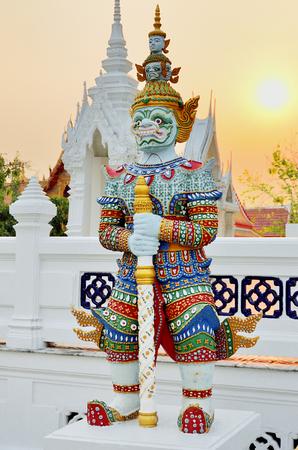 titan: Thai traditional titan sculpture with sunset sky