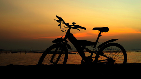 Mountain bike silhouette with sunset sky, Thailand photo
