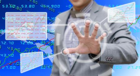 analyzer: Analyzer working with touch screen on virtual board Stock Photo