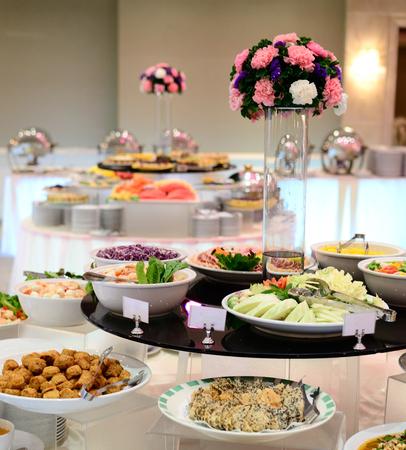 Thai buffet table in restaurant, Thailand photo