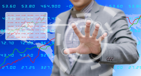 Businessman searching the stock exchange data  photo