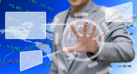 touch screen computer: Investor analyzing data with touch screen computer Stock Photo