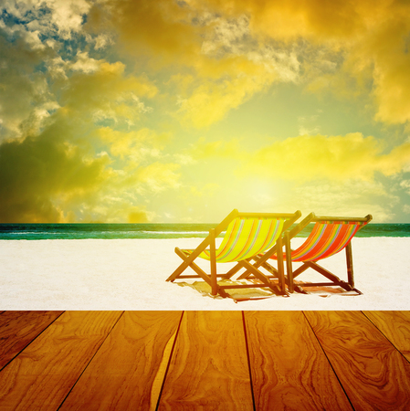 Beach chairs with summer sea and sunset sky background photo