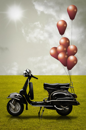Retro scooter and colorful balloon in vintage style photo