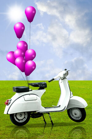 Retro scooter and colorful balloon with nice landscape background photo