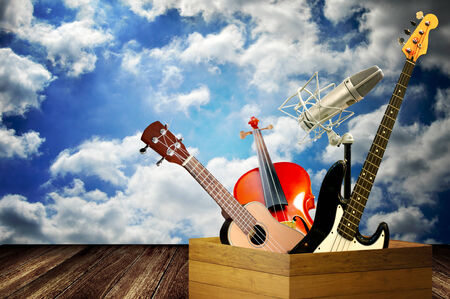 Music instrument in wooden box with cloudy sky background photo