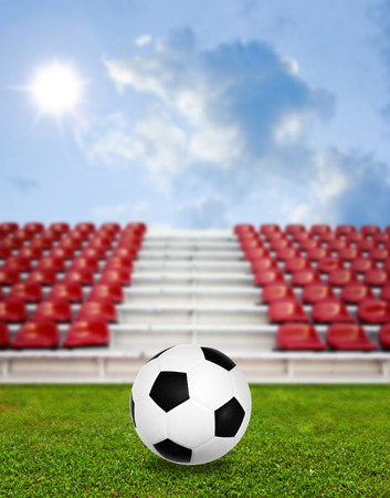 Soccer ball in sport arena with nice sky background photo