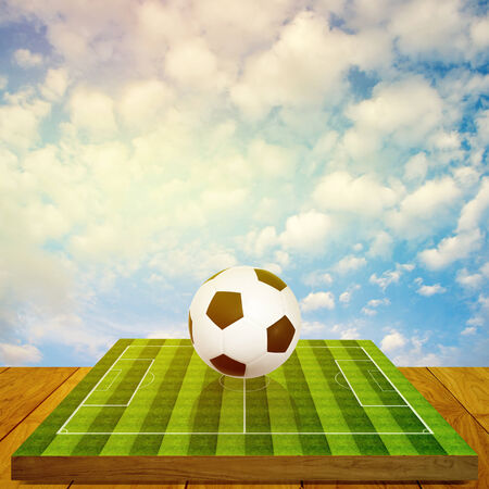 kickoff: Ball on soccer field board game with sky