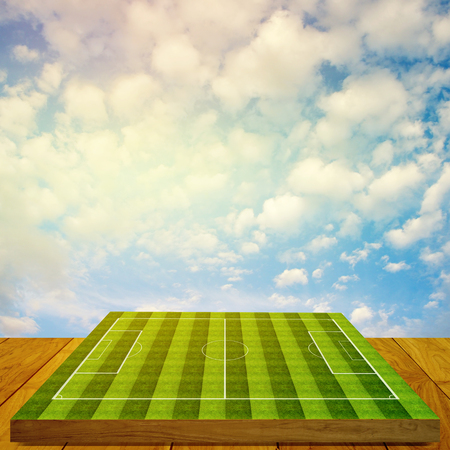 Soccer field board game on wooden floor with nice sky  photo