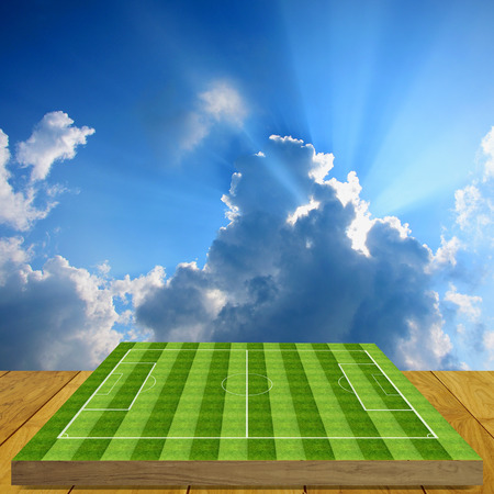 Soccer field board game on wooden floor with nice  photo