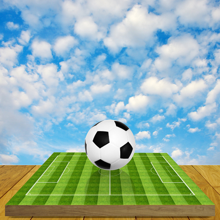 Ball on soccer field board game with sky  photo
