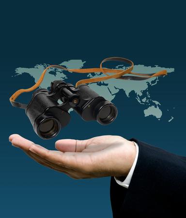 Vison concept, Binocular in businessman hand photo