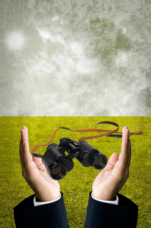 Vision concept, Binocular in businessman hand photo