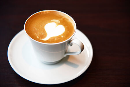 Hot coffee cup on table photo