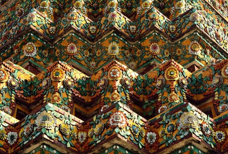 refinement: Nice ancient art tile pattern on pagoda in Thai style, Thailand