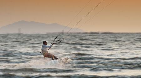 CHONBURI, THAILAND - FEBRUARY 7,Sportman play kite surf on Fabruary 7, 2014 in Bangsean, Chonburi, Thailand