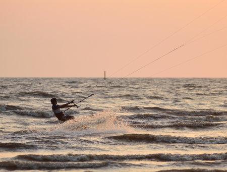 sportman: CHONBURI, THAILAND - FEBRUARY 7 : Sportman play kite surf on Fabruary 7, 2014 in Bangsean, Chonburi, Thailand