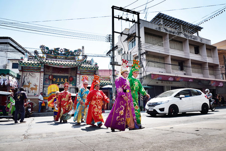 chinese opera: SRIRACHA, THAILAND -  FEBRUARY 5 : Chinese opera actors walking across the street to offering Shrine of the Black Sea on February 5, 2015 in  Sriracha, Chonburi, Thailand Editorial