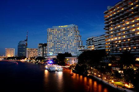 BANGKOK, THAILAND - NOVEMBER 17 : Nice hotel building lighting beside Chao Phraya river on November 17, 2013 in Bangkok, Thailand
