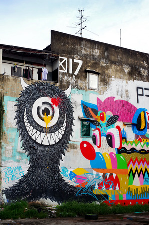 BANGKOK, THAILAND - 21 SEPTEMBER: Giant graffiti on abandon building of Bangkok on September 21, 2013 in Bangkok, Thailand